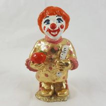 Gold Clown Student with Ruler and Apple