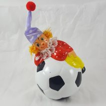 Clown Laying On Soccer Ball Bank