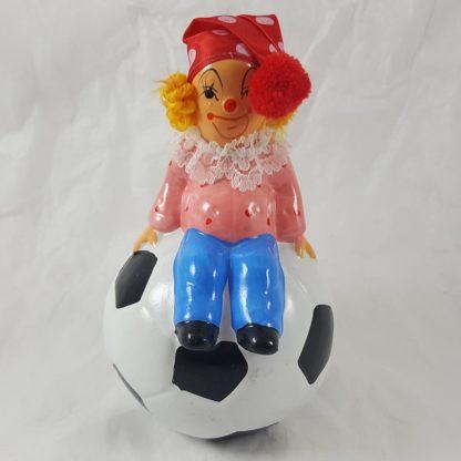 Clown Sitting On Soccer Ball Bank