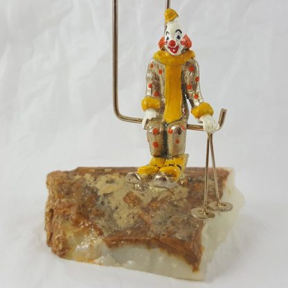 Gold Clown Skiing On Rock with Ski Lift