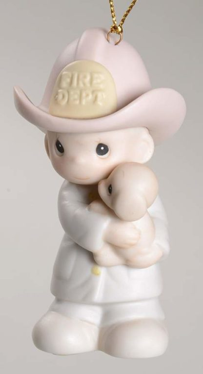 Precious MomentsLove Rescued Me #102385. Porcelain ornament of a Fireman holding a puppy.