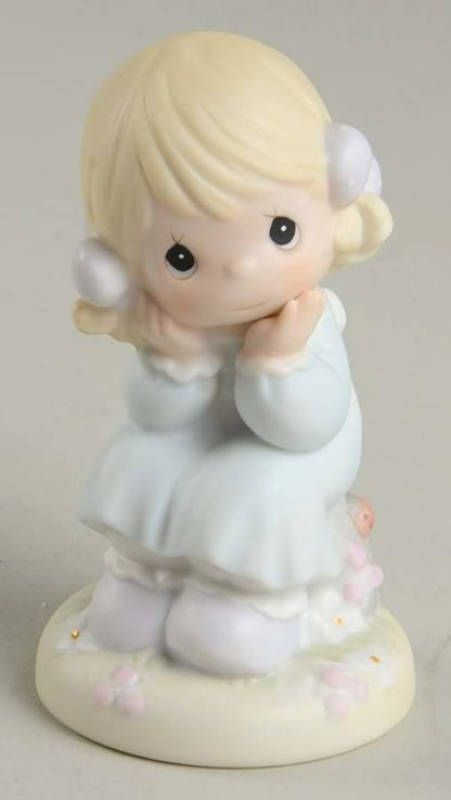 Porcelain figurine of girl sitting on chair