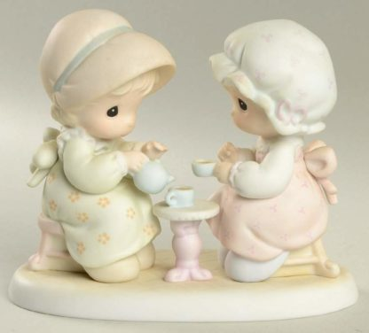 Precious Moments figurine depicts two girls having tea.