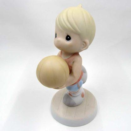 front left of figurine