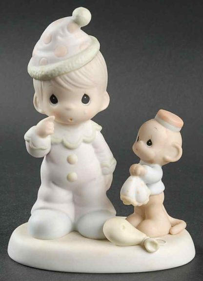 Precious Moments figurine depicts a monkey comforting a sad clown with a popped balloon.