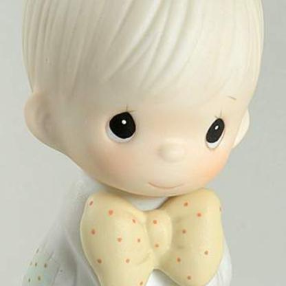 Porcelain figurine depicts a bride groom