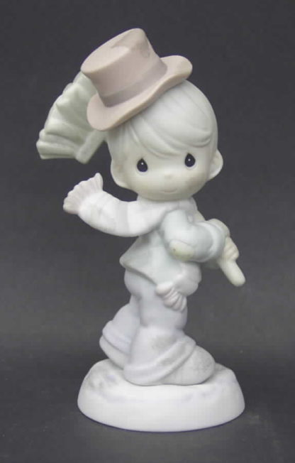 Porcelain Precious Moments figurine depicts a boy chimney sweep in hat and scarf with broom.