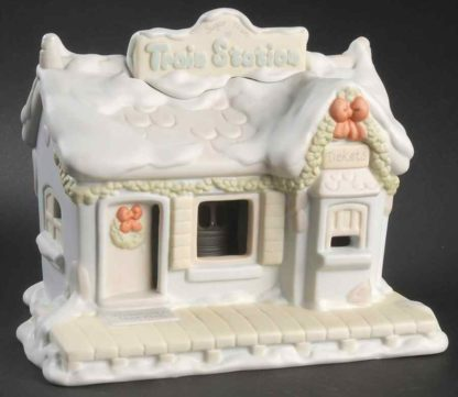 Porcelain Precious Moments Nightlight of train station featuring ticket booth and waiting room.