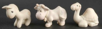 Porcelain figurines of Donkey, Cow and Camel.