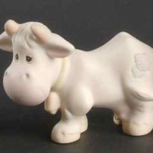 Porcelain figurine of Cow.
