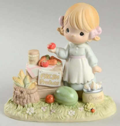Porcelain Precious Moments figurine depicts a girl at a Fresh Produce stand with vegetables and fruit.