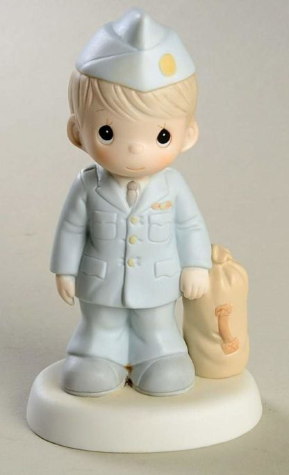 Porcelain Precious Moments figurine depicts an Airman standing beside a duffel bag.