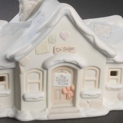 """Porcelain figurine Dr. Sugar's office with the sign, """"The Doctor is Out"""" on the door"""