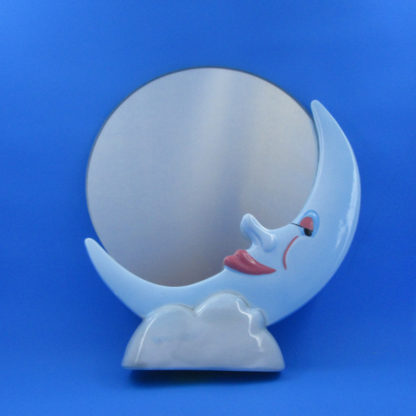round mirror inset in crescent moon sitting on cloud