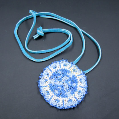 blue white beaded medallion with blue leather laces to tie
